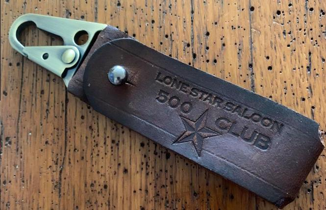 A handmade key strap, one of the new membership gifts at the Lone Star Saloon
