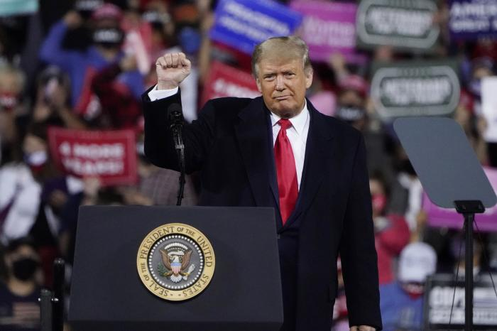 President Donald Trump wraps up his speech at a campaign rally at Fayetteville Regional Airport.