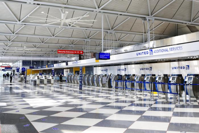 Rows of United Airlines check-in counters at O'Hare International Airport in Chicago are unoccupied amid the coronavirus pandemic.