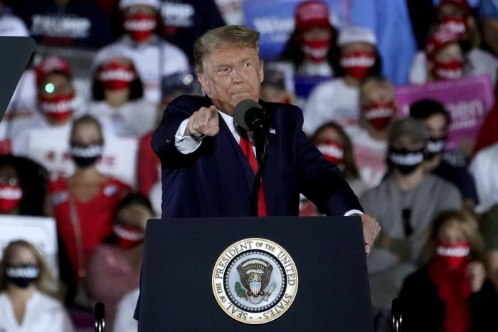 President Donald Trump speaks during a campaign rally at Middle Georgia Regional Airport.