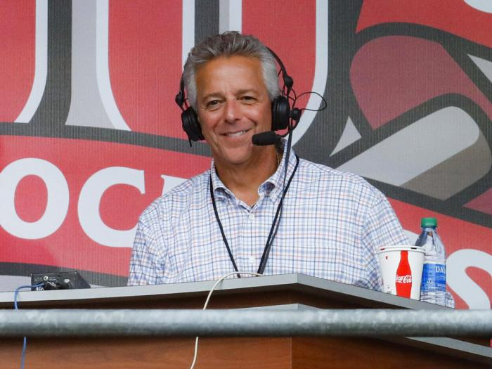 Cincinnati Reds broadcaster Thom Brennaman sits in a special outside booth before the Reds' baseball game against the Milwaukee Brewers in Cincinnati.