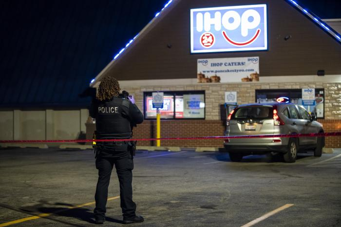 Chicago and Evanston police investigate the scene of a shooting outside an IHOP restaurant in Evanston, Ill., Saturday night, Jan. 9, 2020. (Ashlee Rezin Garcia/Chicago Sun-Times via AP)